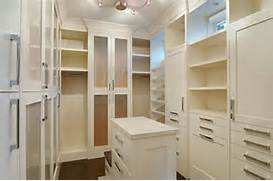Amazing Modern Walk In Closets Walk In Closet Ivory Cabinets And Shelves With Chrome Modern Pulls