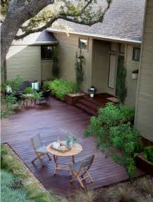 love the dark wood and ground level deck beautiful deck