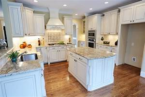 white kitchen cabinets with light countertops - Kitchen