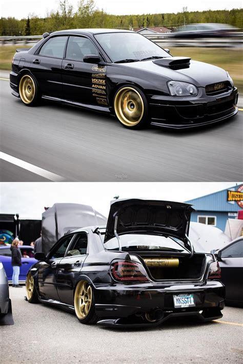 custom black  subaru sti turbo   gold rims