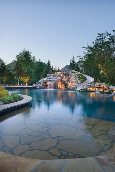 natural boulder waterfall   lagoon style pool  attracts attention  pool