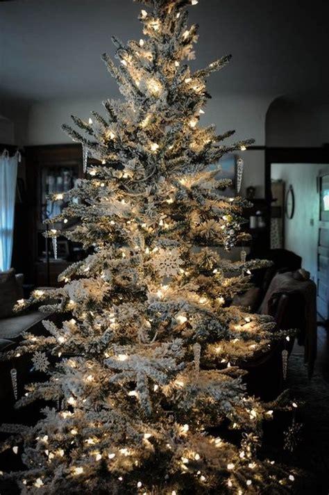 flocked christmas tree decorating winter wonderland