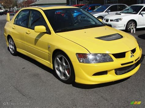 Yellow Mitsubishi Lancer Evo Car Photos Pictures