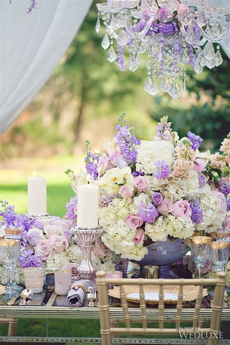 Lilac Decorations Wedding Tables - floral tablescape centrepiece with candles lilac wedding