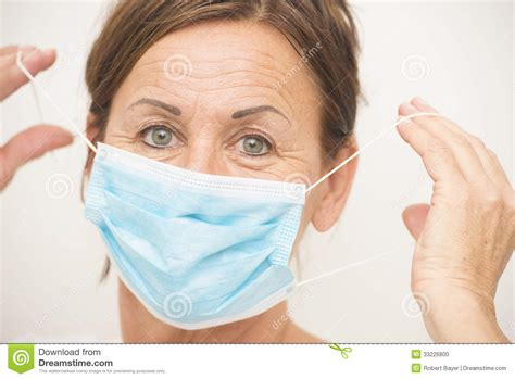 Nurse Or Doctor With Mask Over Face Stock Photo