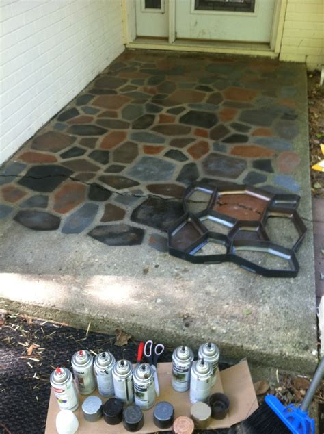 the smart momma spray painted faux stones on concrete patio