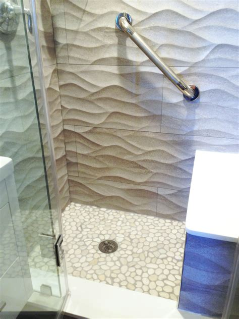 white pebble tile shower floor with textured walls subway tile outlet