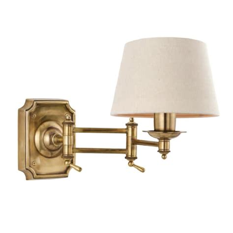 traditional solid brass swing arm wall light ivory faux linen shade