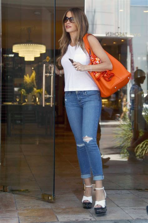 Sofia Vergara In Tight Jeans Shopping At Gearys In