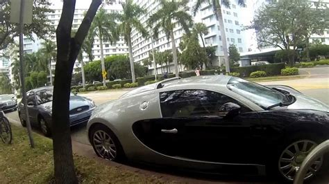 The brand that combines an artistic approach with superior technical innovations in the world of super sports cars. Bugatti in Miami beach ^^ et l'homme qui parle à sa mobilette ;) - YouTube