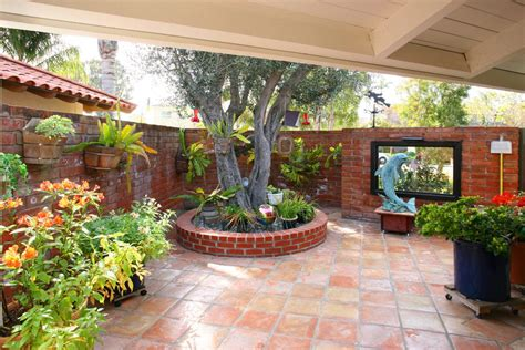 red brick patio mediterranean   garden wall gray