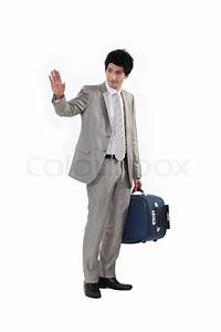 Man with suitcase waving goodbye | Stock Photo | Colourbox
