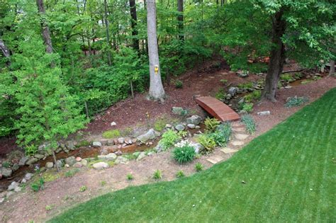 landscape drainage companies drainage ditch between the woods and yard yard pinterest drainage solutions the o jays