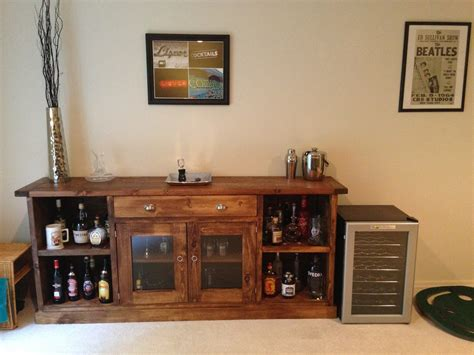 low diy liquor cabinet with glass door and shelves