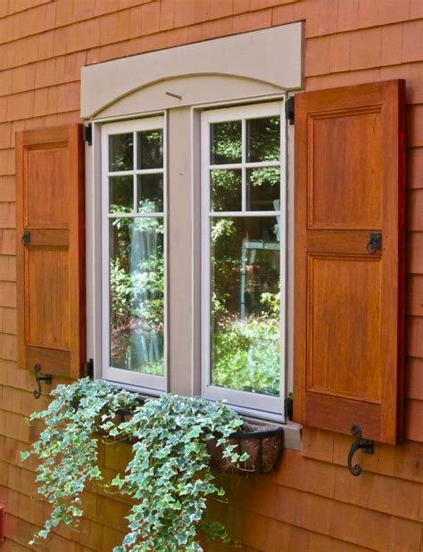 arched window treatment hardware stained panel exterior shutters