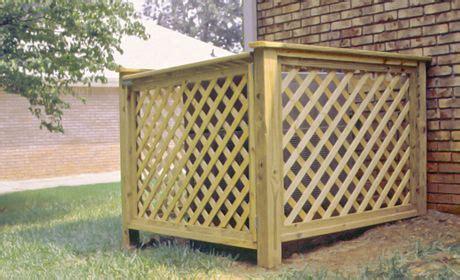 wood lattice enclosing ac unit air conditioner cover