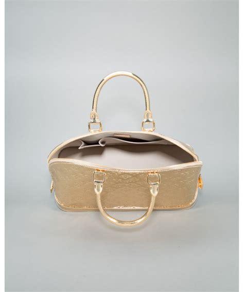lyst louis vuitton pre owned gold monogram mirror alma gm vintage bag  metallic