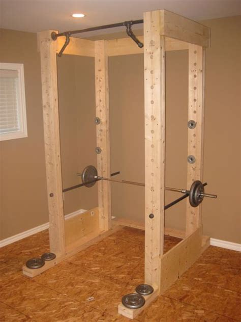 diy squat rack power rack made out of wood and pipe
