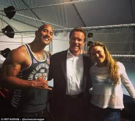WWE Wrestlemania meets UFC as Ronda Rousey throws Triple H ...