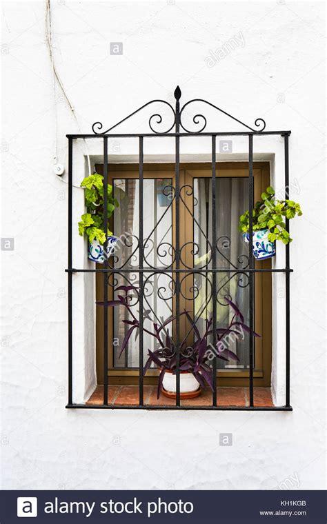 wrought iron window bars stock  wrought iron