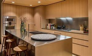Oak Cabinets And Satin-Finish Stainless Steel Make Up This