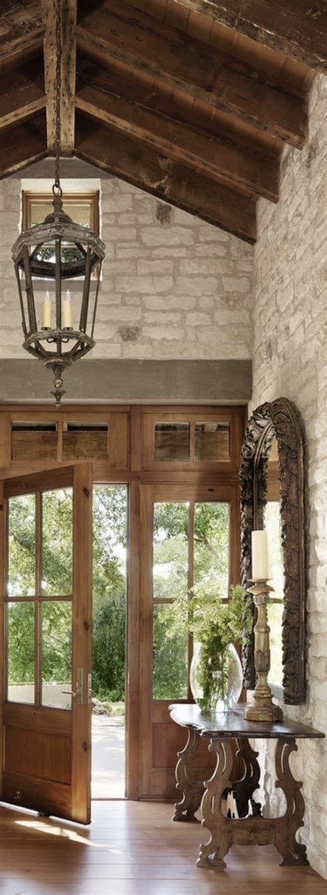 rustic elegance foyer with vault wood beams