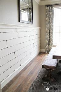Diy distressed plank wall shanty 2 chic for Distressed wood planks for walls