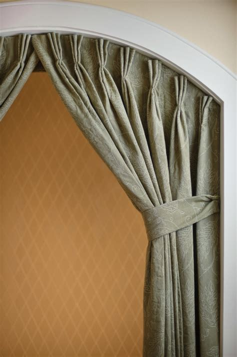 what hardware did you use to hang the curtains in the archway