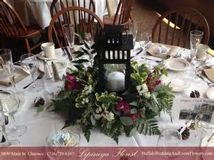 rustic arch for wedding lantern wedding centerpiece buffalo wedding event flowers by lipinoga florist