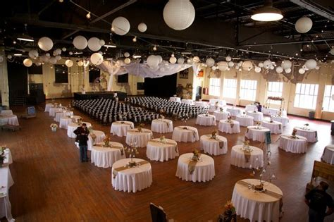 the ceremony and reception in one spot white tables paper lanterns and string lights