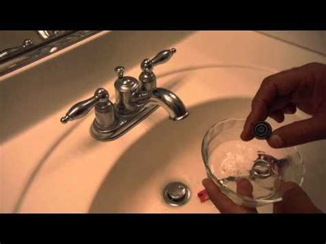 clean  bathroom sink faucet aerator screen