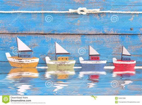 Toy Boat In Sea by Shabby Toy Boats In A Row On Blue Background On The Sea