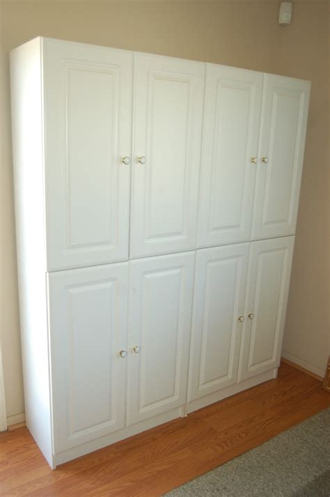 Small White Wooden Cabinet With Single Door Combined With