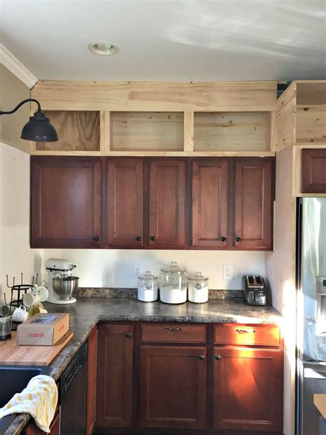 how to add height to kitchen cabinets building cabinets up to the ceiling from thrifty decor 9281