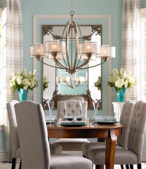 dining room lighting high drama and low profile merge effortlessly in this Traditional