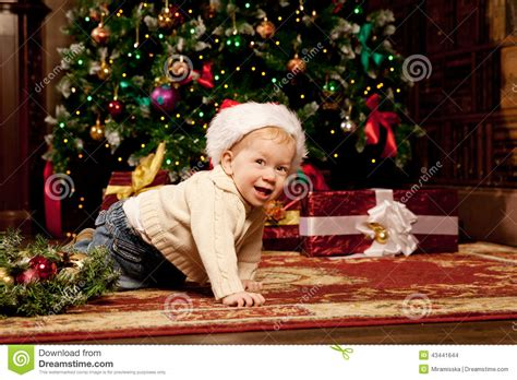 Baby Near The Christmas Tree. Little Boy Celebrati Stock