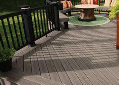 dark grey brown deck railing  lighter greyish painted