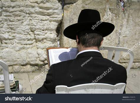 Hasidic Jew Reading Torah At The Wailing Western Wall