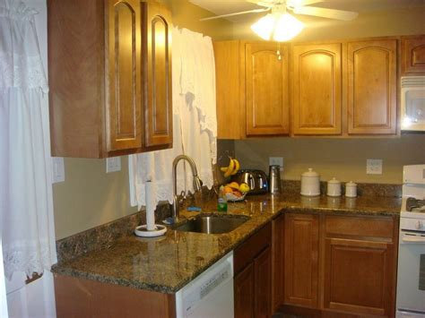 kitchen cabinet colors with white appliances light wood kitchen cabinets with white appliances 9080