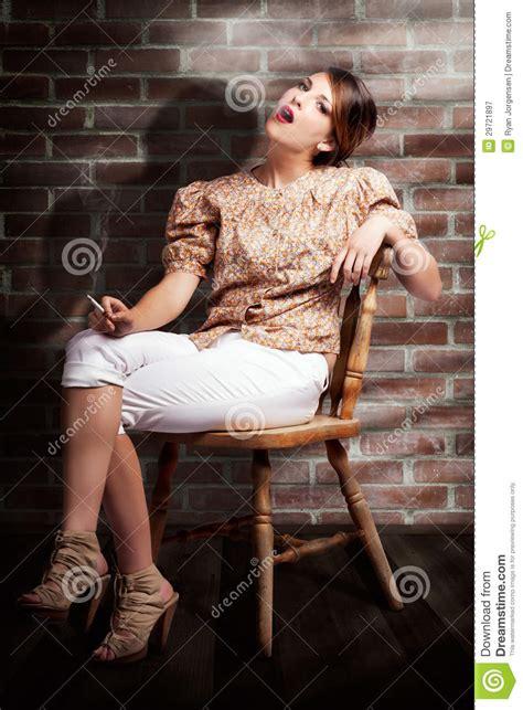grunge girl smoking cigarette  dark interior stock image