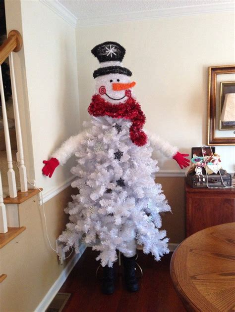 christmas tree decorated with snowmen make a snowman out of a tree craft projects