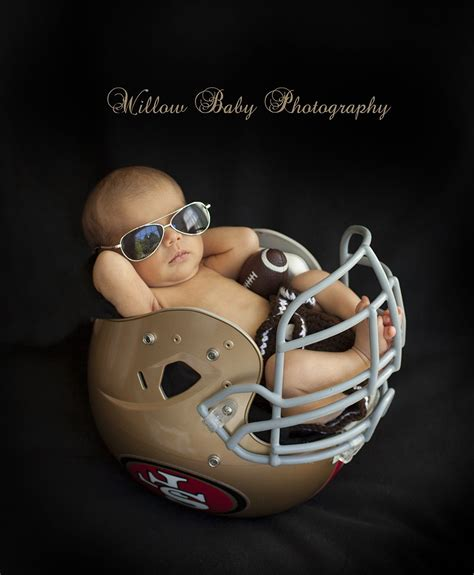 newborn football picture  baby boy wearing sunglasses