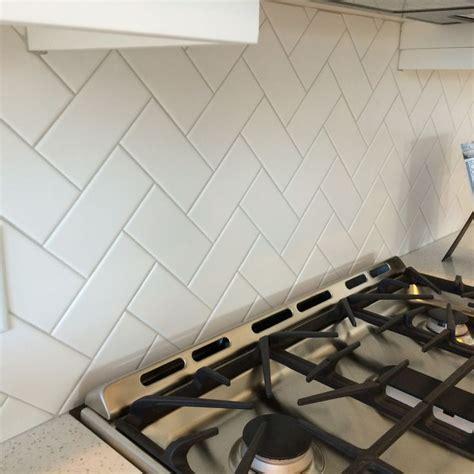 white subway tile   herringbone pattern  light