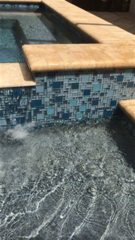 Npt Pool Tile Martinique by This Mixed Geometric And Freeform Style Pool And Spa