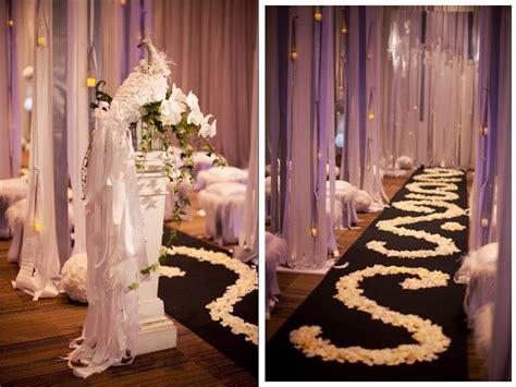 Elegant White Wedding Ceremony Decor And Aisle Covered In