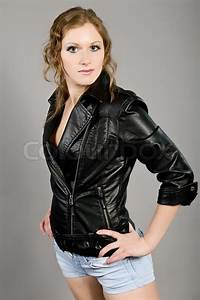 Girl In A Leather Jacket And Dark Blue Shorts