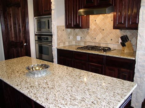 tile backsplash with giallo ornamental granite countertops
