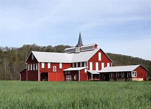 stately red barn with elongated clerestory cupola With barn cupola images