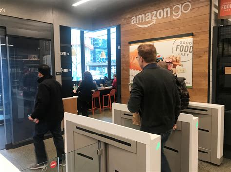A customer walks out of the Amazon Go store, without ...