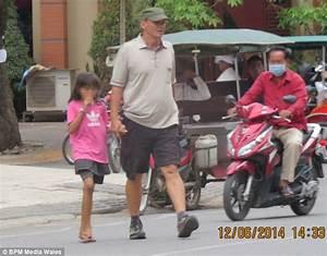 British paedophile suspect pictured walking hand-in-hand ...